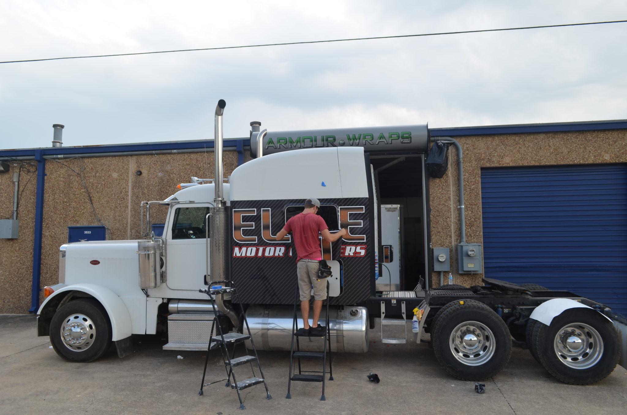 during semi truck wrap Elite Motor Carriers