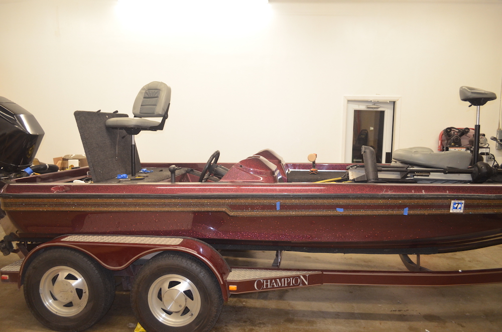 before camouflage fishing boat wrap